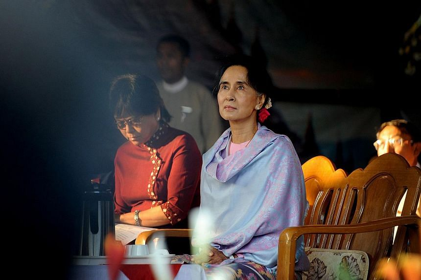 Myanmar opposition leader Aung San Suu Kyi (centre) attending a ceremony to mark the 100th birthday of her father, independence hero Aung San, in the remote central Myanmar town of Natmauk on Feb 13, 2015. -- PHOTO: AFP