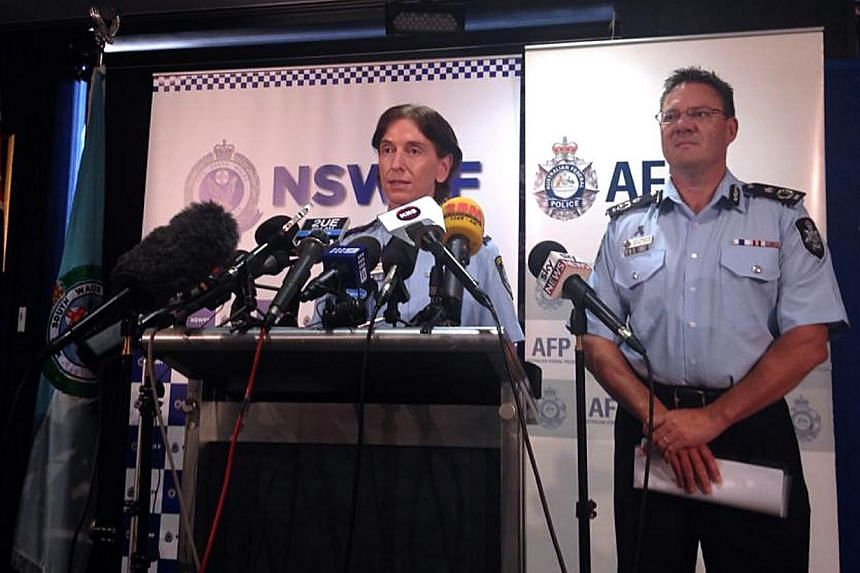 Australian Federal Police Deputy Commissioner Michael Phelan (right) listens as New South Wales Deputy Police Commissioner Catherine Burn speaks during a media conference in Sydney on Feb 11, 2015. The police and a prayer hall were among potenti
