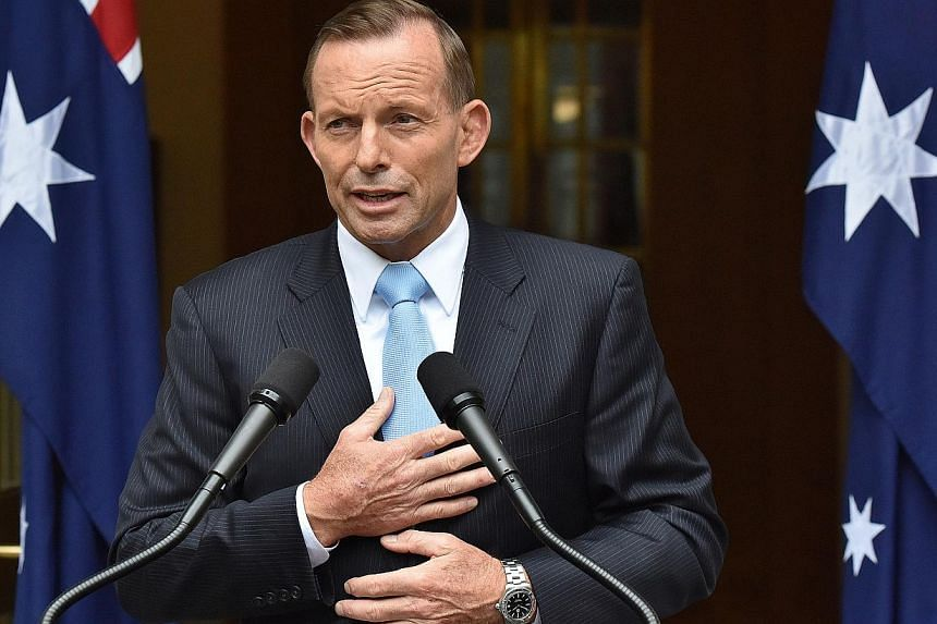 """Australian Prime Minister Tony Abbott came under fire on Feb 13, 2015, over controversial comments on the arrest of two terror suspects and for referring to a """"holocaust"""" of job losses, capping a horror week. -- PHOTO: BLOOMBERG"""