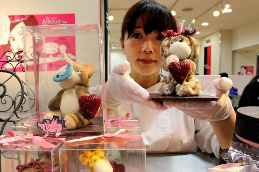 A Japanese chocolatier displaying animal-shaped chocolates at the Takashimaya department store for the upcoming Valentine's Day in Tokyo, on Feb 4, 2015. -- PHOTO: AFP