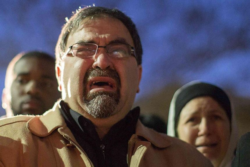 Namee Barakat, father of shooting victim Deah Shaddy Barakat, cries as a video is played during a vigil on the campus of the University of North Carolina in Chapel Hill, North Carolina Feb 11, 2015. -- PHOTO: REUTERS