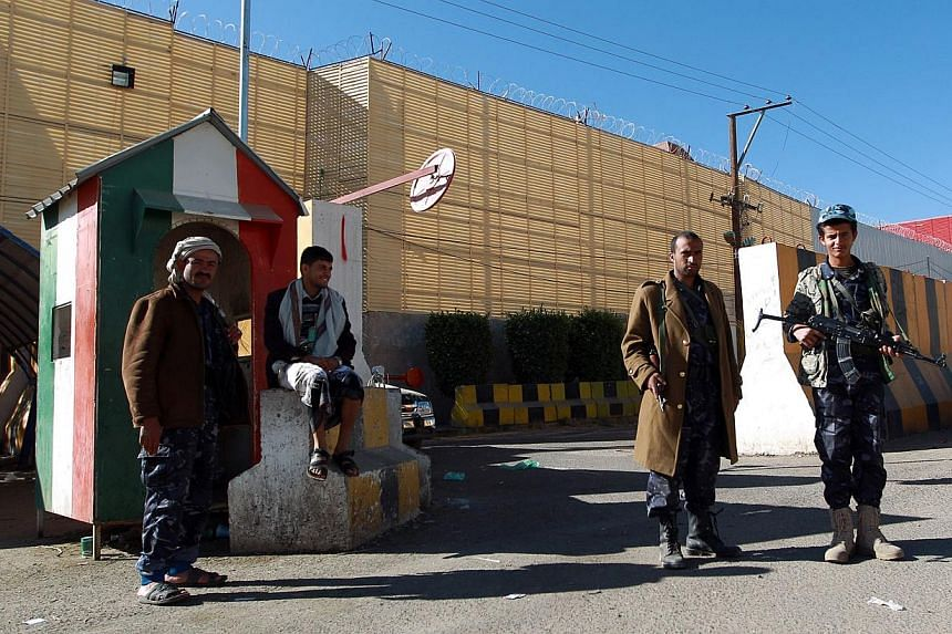 Yemeni security forces stand guard outside the Italian embassy in Sanaa on Feb 13, 2015. Saudi Arabia, Germany and Italy became the latest countries to withdraw embassy staff from Yemen on Friday as an exodus of foreign diplomats gathered pace due to