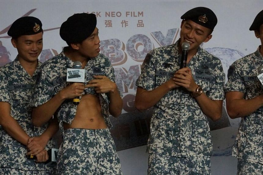 Ah Boy actor Wang Weiliang (second from left) shows off his abs, next to him on the right is Tosh Zhang, and Joshua Tan. -- ST PHOTO: GWENDOLYN NG