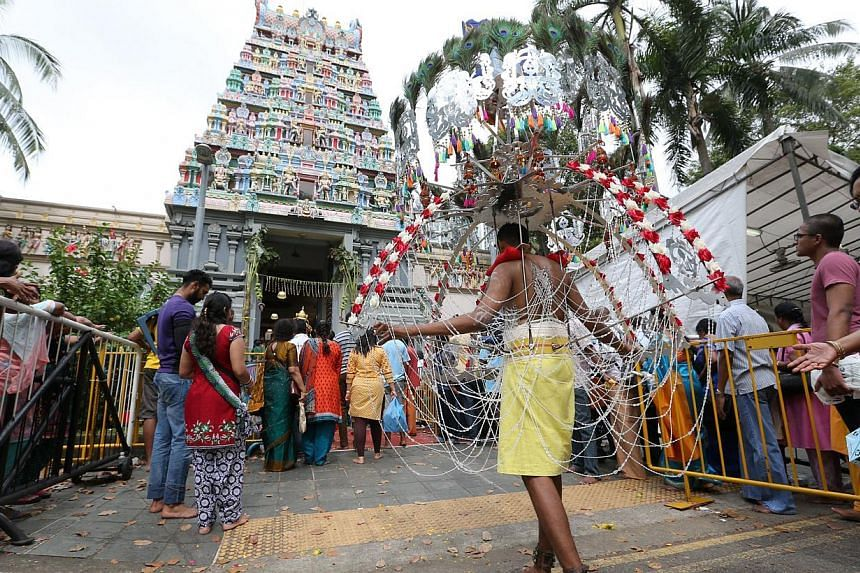 Devotees in a procession before entering Sri Thendayuthapani Temple - the end point - on Tank Road. -- ST PHOTO: ONG WEE JIN