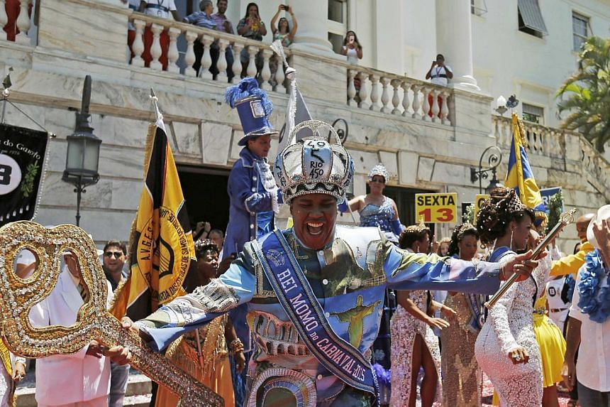 """""""King Momo"""" Wilson Dias da Costa Netodances during the handing over of the ceremonial key to the city, at Cidade Palace in Rio de Janeiro Feb 13, 2015. The event officially kicks off the 2015 carnival week in Rio. -- PHOTO: REUTERS"""
