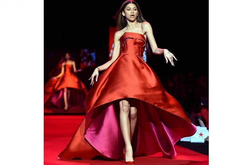 US actress Zendaya walks the runway at the Go Red For Women Red Dress Collection 2015 presented by Macy's fashion show during Mercedes-Benz Fashion Week Fall 2015 at The Lincoln Center in New York on Feb 12, 2015. -- PHOTO: AFP