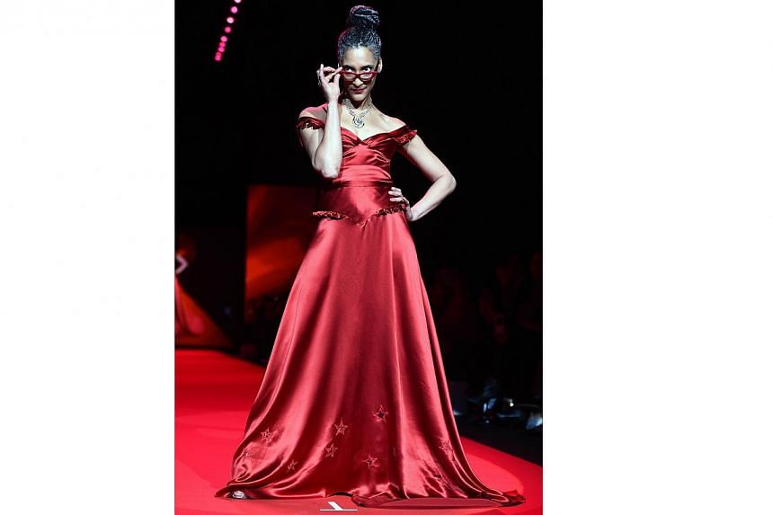 US chef and television personality Carla Hall walks the runway at the Go Red For Women Red Dress Collection 2015 presented by Macy's fashion show during Mercedes-Benz Fashion Week Fall 2015 at The Lincoln Center in New York on Feb 12, 2015. -- PHOTO:
