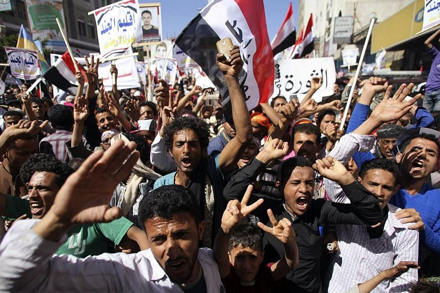 Anti-Houthi protesters shout slogans to commemorate the fourth anniversary of the uprising that toppled former president Ali Abdullah Saleh, in Yemen's southwestern city of Taiz on Feb 11, 2015. -- PHOTO: REUTERS