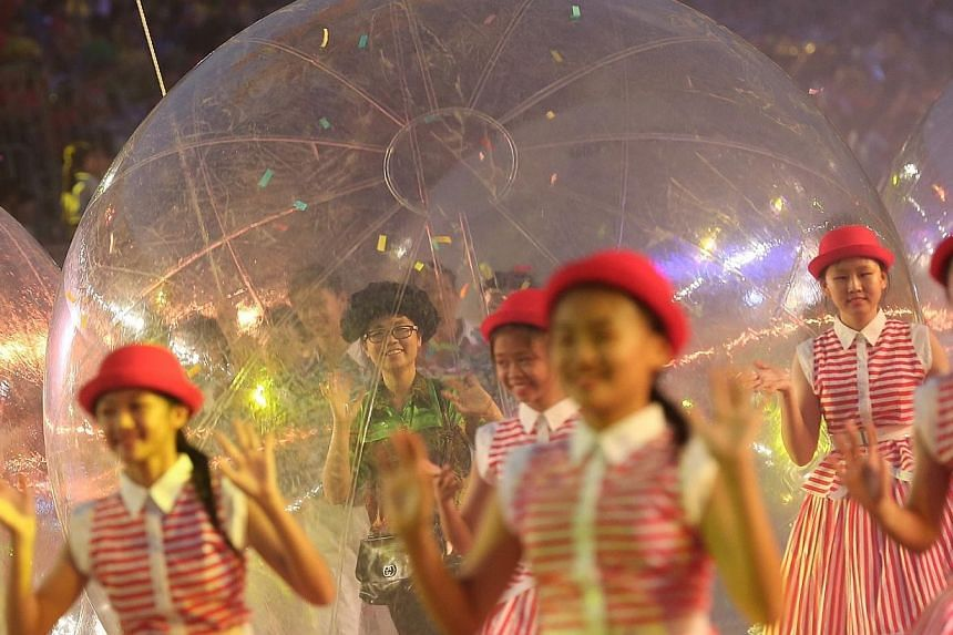 The Chingay SG50 National Education (NE) Show for 11,000 students from 60 primary and secondary schools held at the F1 Pit Building, on Feb 14, 2015. -- ST PHOTO: NEO XIAOBIN