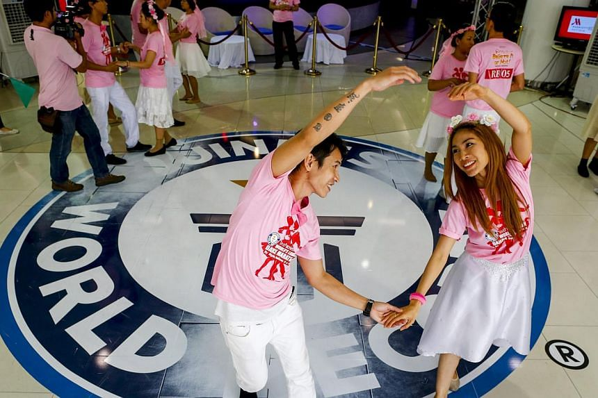 Couples dancing during a Guinness World record attempt for the Ripley's Believe It or Not! world's longest dance marathon in Pattaya, Thailand, onFeb 14,2015. -- PHOTO: EPA
