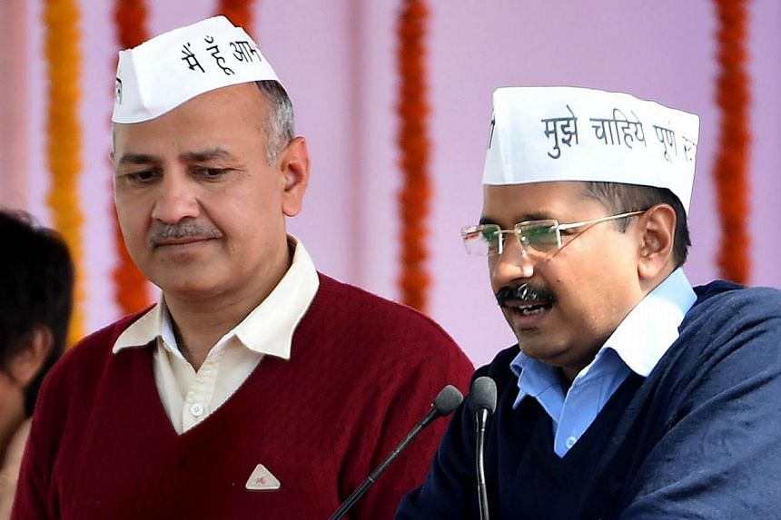 Aam Aadmi Party (AAP) president Arvind Kejriwal (right), with fellow AAP minister Manish Sisodia, addressing supporters during his swearing-in ceremony as Delhi chief minister in New Delhi on Feb 14, 2015. -- PHOTO: AFP