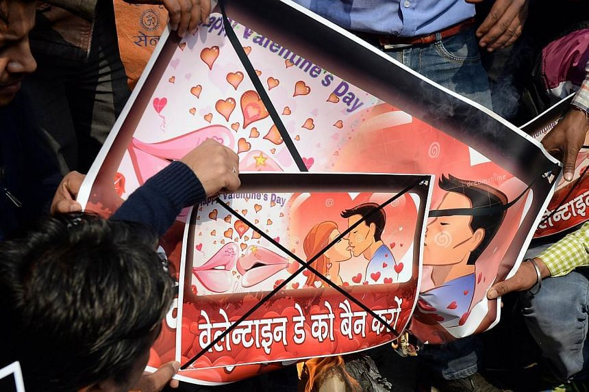 Activists of right-wing Hindu organisation Hindu Sena shouting anti-Valentine's Day slogans as they prepare to burn placards during a protest in New Delhi on Feb 12, 2015. -- PHOTO: AFP