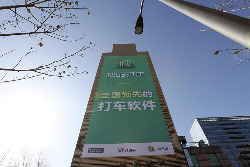 A Kuaidi Dache advertisement in Beijing. The app and Didi Dache together control 99 per cent of China's domestic market for booking taxis by smartphone. -- PHOTO: REUTERS