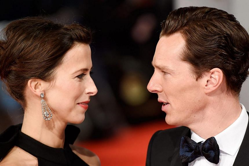 British actor Benedict Cumberbatch (right) and his fiancee Sophie Hunter arrive on the red carpet for the 2015 British Academy Film Awards ceremony at The Royal Opera House in London, Britain, on Feb 8,2015. -- PHOTO: EPA