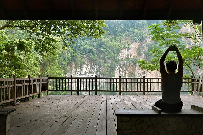 A jogger taking a rest at the Kruing Hut which overlooks the Hindhede Quarry at Bukit Timah Nature Reserve. -- ST PHOTO: KUA CHEE SIONG