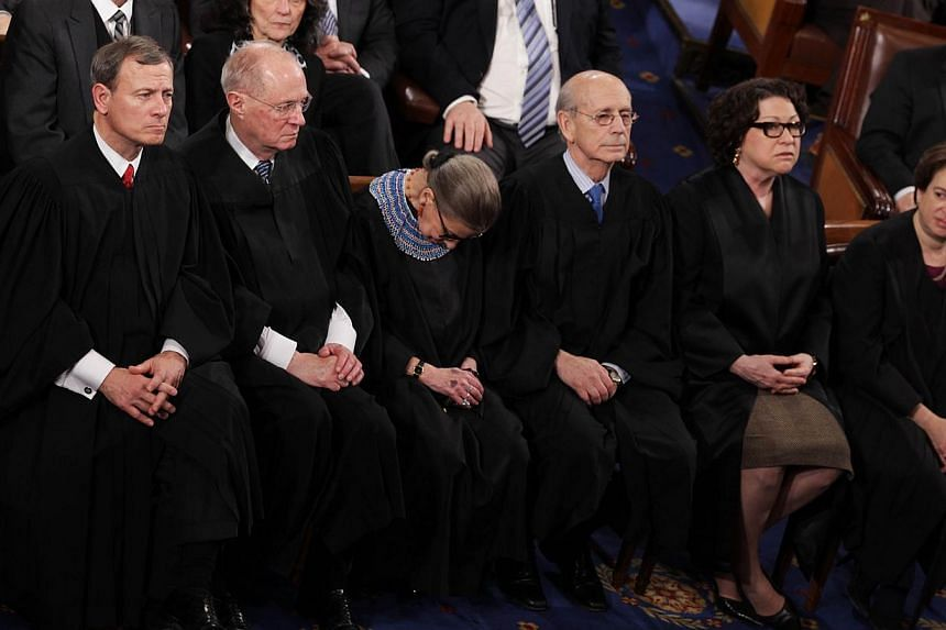 US Supreme Court Justice Ruth Bader Ginsburg (third from left) apparently nodding off while attending President Barack Obama's State of the Union address in January. -- PHOTO: AFP