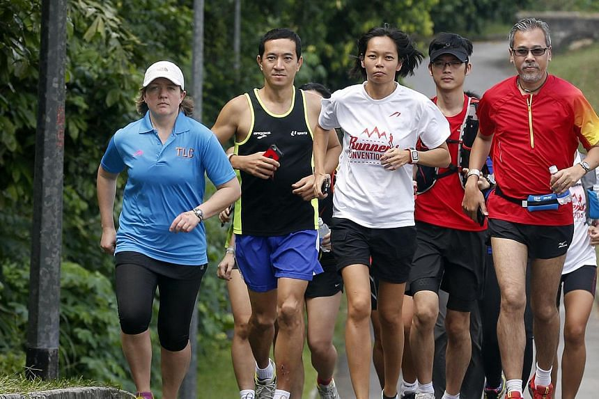 Ms Lizzy Hawker (left), five-time winner of The North Face Ultra Trail du Mont Blanc mountain ultra-marathon, running with local runners, including (third from left) Singapore ultramarathoner Liew Wei Yong. -- ST PHOTO: LAU FOOK KONG