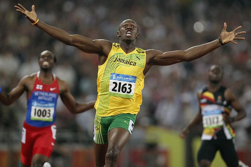 Usain Bolt celebrates winning the men's 200m final at the 2008 Beijing Olympics. The Jamaican sprint sensation said he is planning to retire after the 2017 World Championships in London.-- PHOTO: ACTION IMAGES / BRANDON MALONE