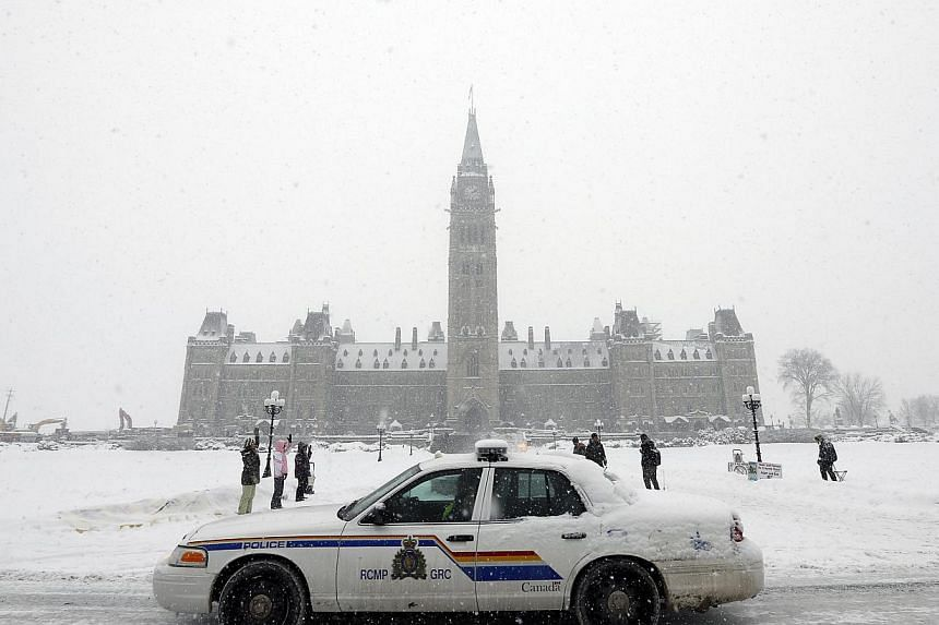 A Royal Canadian Mounted Police vehicle at Parliament Hill in Ottawa on Feb 4, 2015. Canadian police said on Feb 13 that they had foiled a plot that would have seen an armed duo carry out a shooting spree in the city of Halifax on Valentine's Day. --
