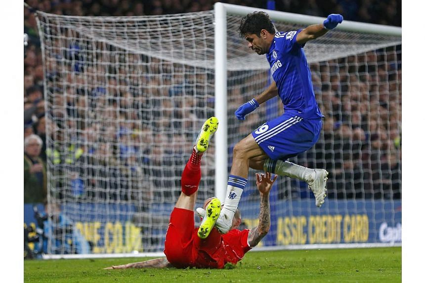 Chelsea's Diego Costa (top) appears to stamp on Liverpool's Martin Skrtel during their English League Cup semi-final second leg soccer match at Stamford Bridge in London Jan 27, 2015. -- PHOTO: REUTERS