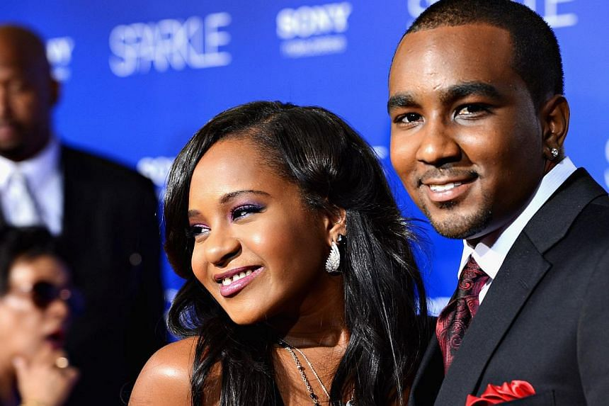 Nick Gordon, who calls himself the husband of Bobbi Kristina Brown (both pictured above), cannot visit her at the hospital where she is being treated after having been found face down and unresponsive in a bathtub last month, Brown's cousin told a lo