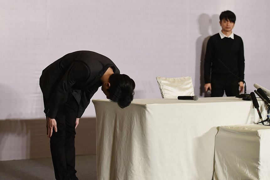 Jaycee Chan, the son of Hong Kong actor Jackie Chan, bowing after a press conference in Beijing on Feb 14, 2015 following his release from jail. -- PHOTO: AFP