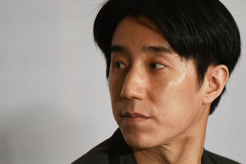 Jaycee Chan, the son of Hong Kong actor Jackie Chan, looking towards the exit near the end of a press conference in Beijing on Feb 14, 2015 following his release from jail.-- PHOTO: AFP