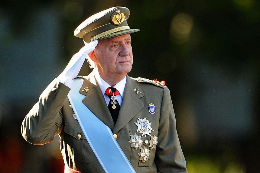 Spain's former king Juan Carlos, seen here in this Oct 12, 2011, file photo, has lodged an appeal against a paternity suit brought by a woman claiming to be his daughter, a judicial source said on Saturday. -- PHOTO: AFP