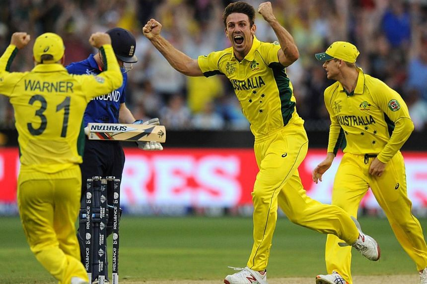 Australia's Mitchell Marsh (centre) celebrates the wicket of England's Joe Root during their 2015 Cricket World Cup match at the Melbourne Cricket Ground (MCG) on Feb 14, 2015. -- PHOTO: AFP