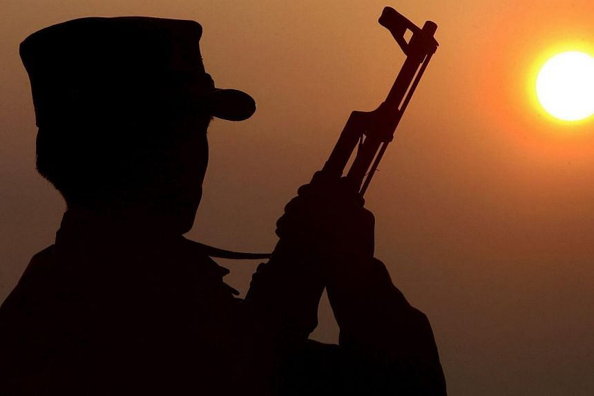 A file picture showing a Shan State Army soldier (SSA) silhouetted against the sun. The country's national army launched fresh air atrikes against rebels in the north on Feb 14, 2015. -- PHOTO: EPA