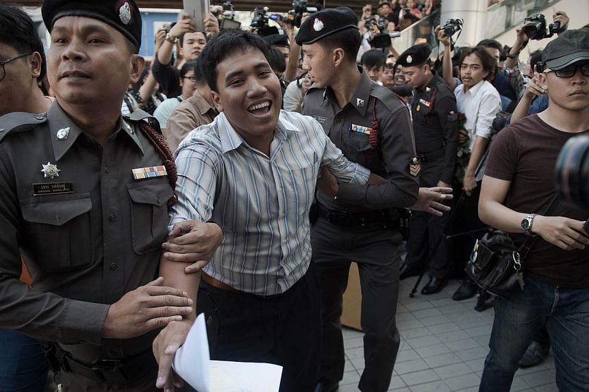 A demonstrator (centre) is arrested by police officers as he was making a speech outside the Art and Cultural centre during a rally in Bangkok on Feb 14, 2015.-- PHOTO: AFP