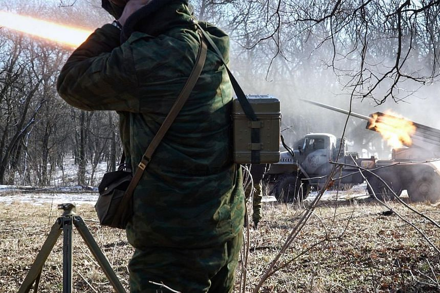 Pro-Russian rebels stationed in the eastern Ukrainian city of Gorlivka, Donetsk region, launching missiles from a Grad launch vehicle toward a position of the Ukrainian forces in Debaltseve, about 35km east of Gorlivka, on Feb 13, 2015. -- PHOTO: AFP