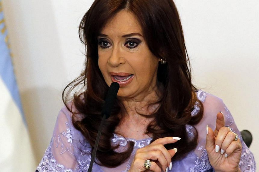 Argentine President Cristina Kirchner (above) was formally accused on Friday of shielding Iranian officials from prosecution over a 1994 bombing at a Buenos Aires Jewish centre, prosecutors said. -- PHOTO: REUTERS