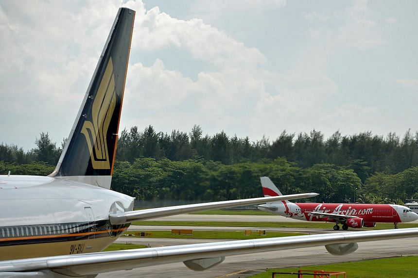 More airlines are cutting or removing fuel surcharges amid a sharp fall in oil prices in recent months, with Singapore Airlines among them. -- PHOTO: ST FILE