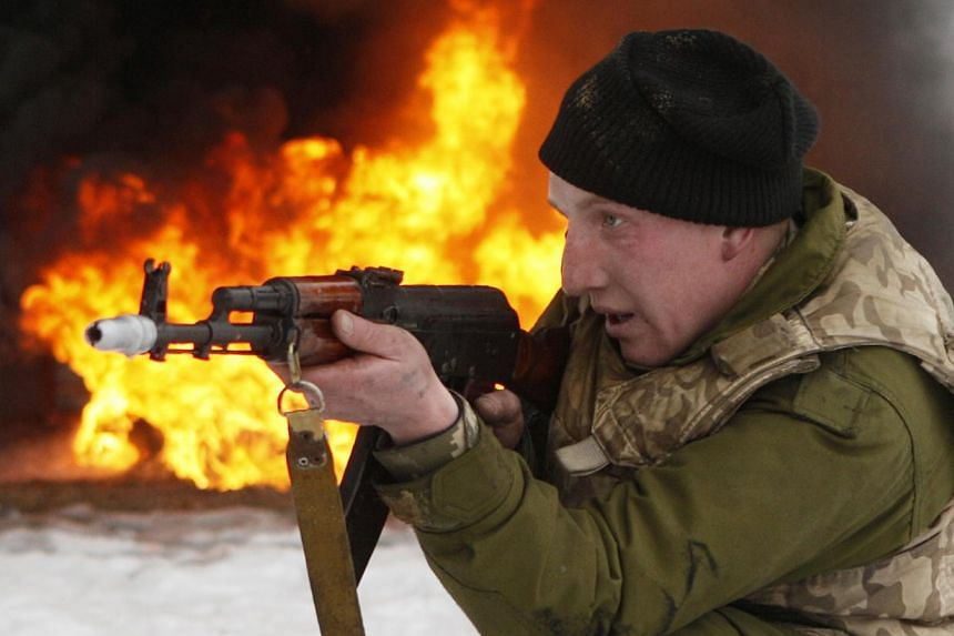 A newly mobilised soldier trains with a weapon at a Ukrainian ground forces training centre in the Chernihiv region Feb 13, 2015. The United States charged Friday that Russia was continuing to deploy heavy weapons in eastern Ukraine, before a ceasefi