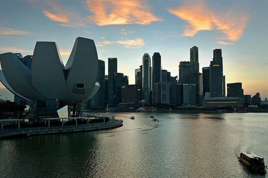 Bumboats travelling on the Marina Bay with the ArtScience Museum and the Marina Bay financial district in the background. Singapore's final Q4 GDP figures are slated to be released this week. -- ST PHOTO: KUA CHEE SIONG