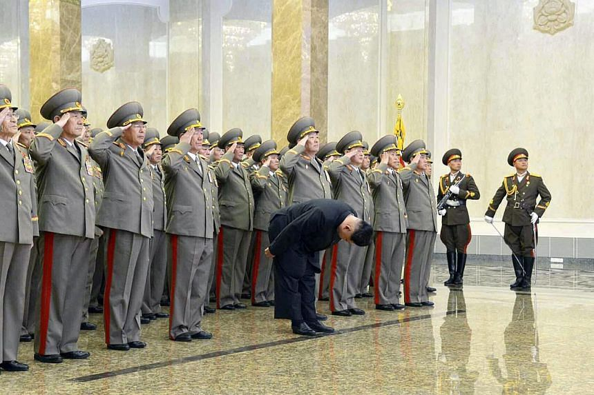 A picture released by the Rodong Sinmun, the newspaper of North Korea's ruling Workers Party, shows North Korean leader Kim Jong Un (centre) bowing to the embalmed corpse of his father Kim Jong Il, at the Kumsusan Palace of the Sun in Pyongyang, Nort