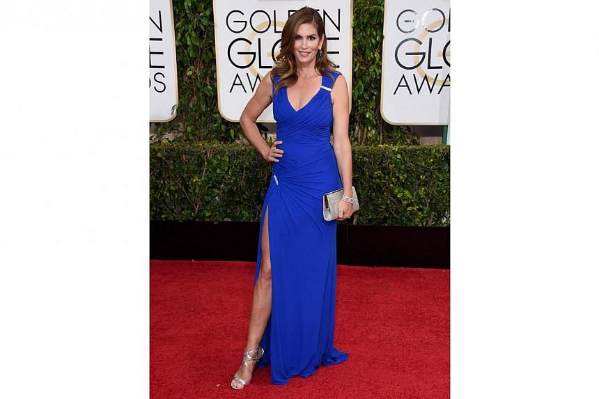 Model Cindy Crawford attending the 72nd Annual Golden Globe Awards at The Beverly Hilton Hotel on Jan 11, 2015, in Beverly Hills, California. -- PHOTO: AFP