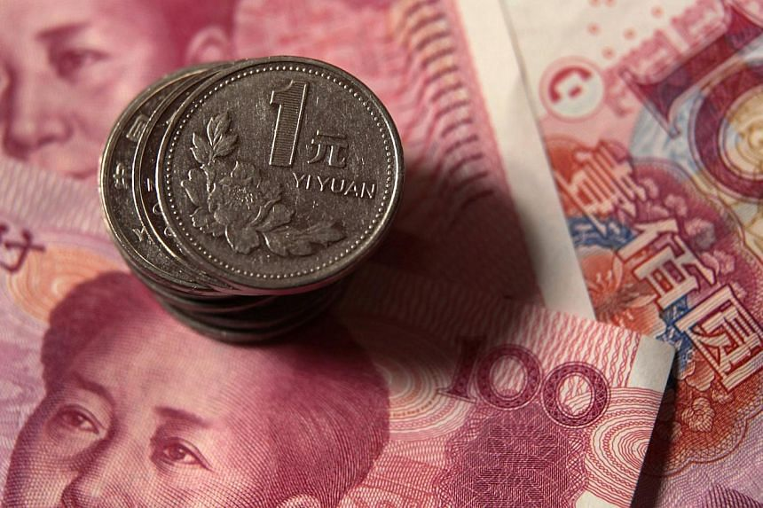 China's yuan declined the most in two weeks as the foreign-exchange regulator highlighted concerns over capital outflows amid indications money is leaving the nation. -- PHOTO: REUTERS