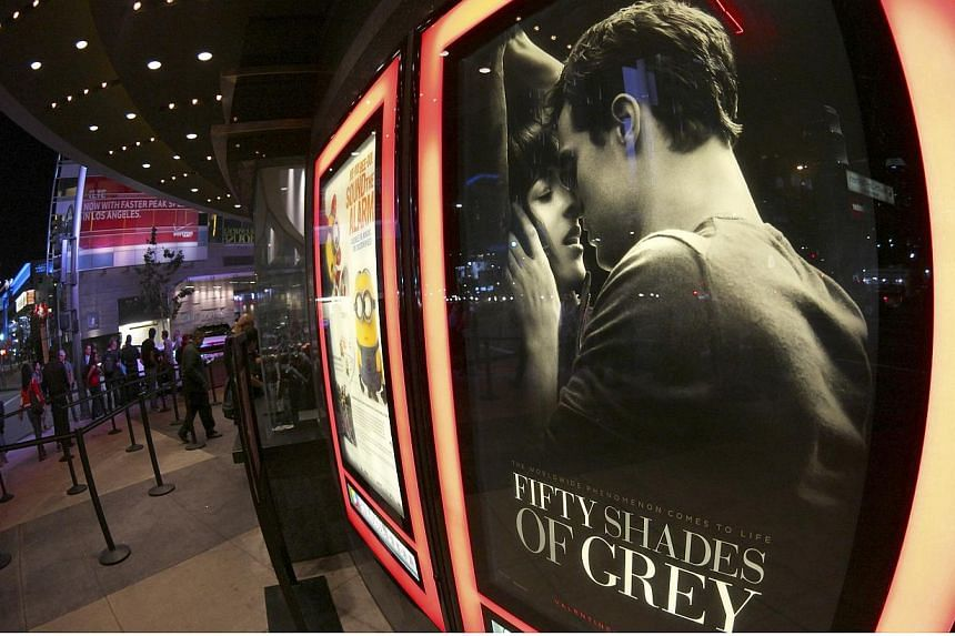 A film poster for Fifty Shades Of Grey is pictured at Regal Theater in Los Angeles, California on Feb 12, 2015.-- PHOTO: REUTERS