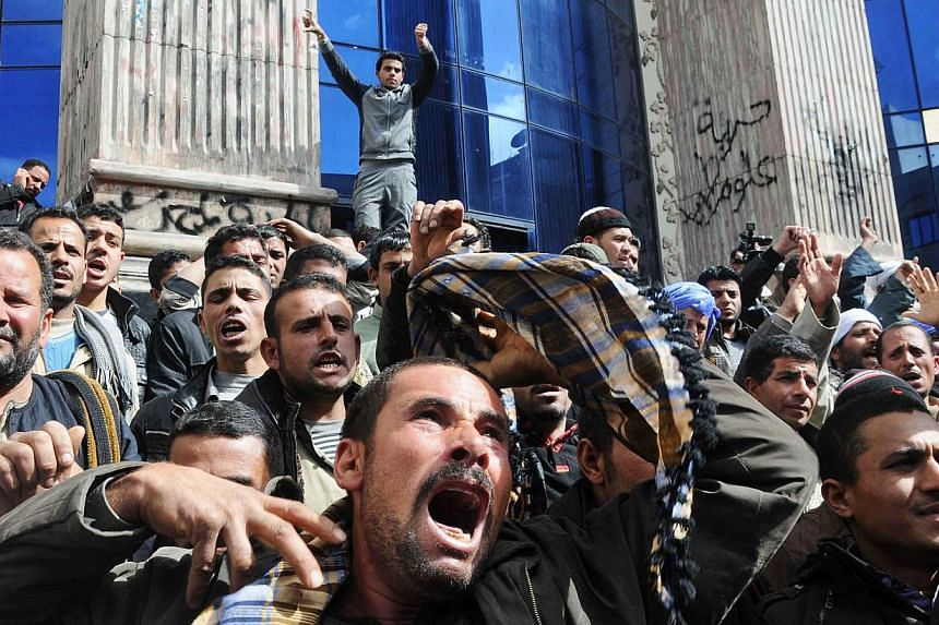 Egyptians protest what they characterise as Government inaction in reaction to the kidnapping of Copts in Libya, Cairo, Egypt on Feb 13, 2015.The United Arab Emirates expressed backing Monday for a strong Egyptian response to video released by