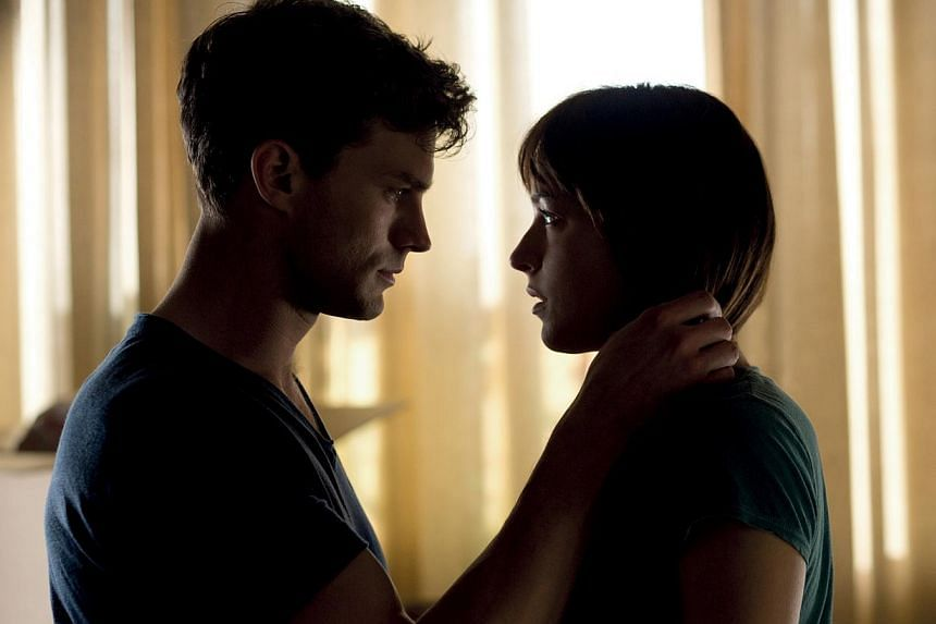 Jamie Dornan and Dakota Johnson star in Fifty Shades Of Grey. -- PHOTO: UNIVERSAL PICTURES
