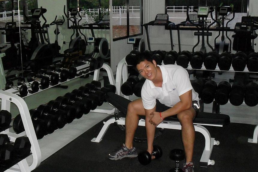Lifting weights at his first gym, Unleash Fitness, in 2009. -- PHOTO: COURTESY OF CHUNG TZE KHIT