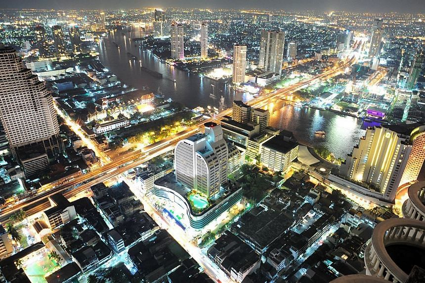 Night view of Bangkok, Thailand. The country's economy grew less than expected in October-December and had full-year 2014 growth of only 0.7 per cent, as exports and consumption remained weak long after a May coup aimed at helping to spur recovery. -