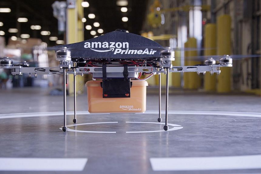 The Amazon.com Inc. Prime Air octocopter is seen at an undisclosed location in this undated handout photograph. The use of drones for goods delivery is unlikely to happen anytime soon as US authorities concluded that small drones for hire must be flo