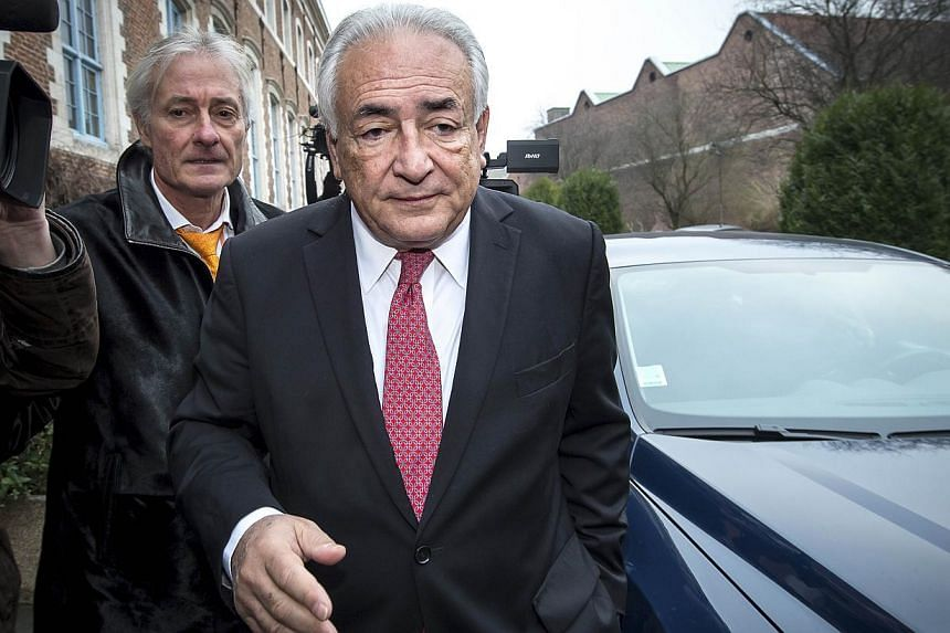 """Former IMF chief Dominique Strauss-Kahn on his way to the Lille courthouse to attend a trial where he is charged alongside 13 others for """"aggravated pimping"""" on Feb 12, 2015. -- PHOTO: AFP"""