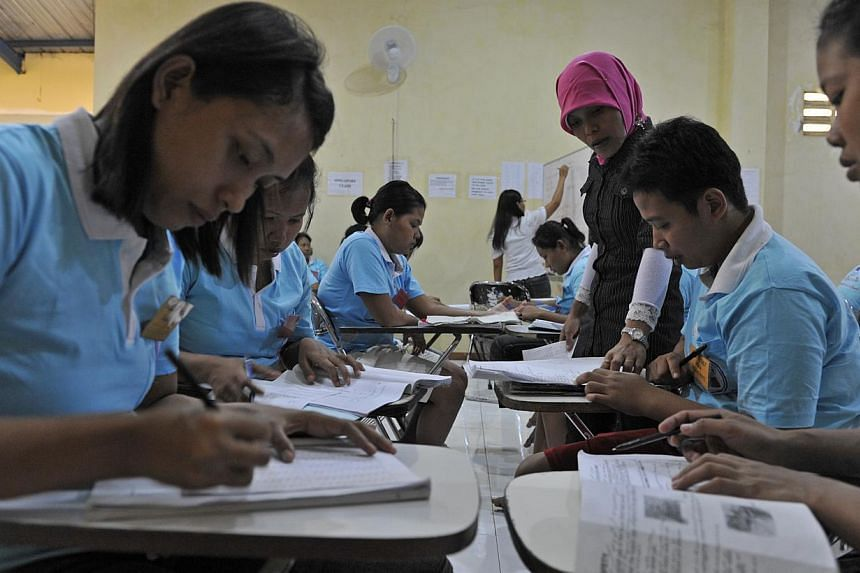 Indonesian maids undergoing training at a training centre in Solo, Indonesia, in 2011. -- PHOTO: ST FILE