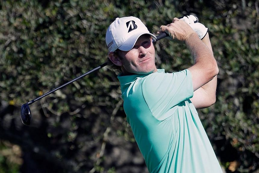 Brandt Snedeker watches his tee shot on the 16th hole during the final round of the AT&T Pebble Beach National Pro-Am at the Pebble Beach Golf Links on Feb 15, 2015 in Pebble Beach, California. Snedeker had aflawless five-under par 67 for a