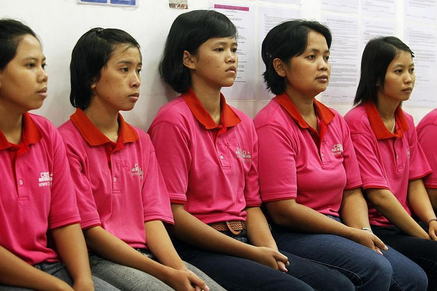 Maids at Crislo Employment Agency in Singapore in 2012. With Indonesia announcing possible plans to cut its supply of domestic helpers, agencies in Malaysia say employers must be ready to pay higher wages and efforts must be made to find new source c