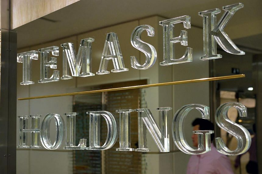 Temasek Holdings sold shares in Alibaba Group Holding in the fourth quarter as the Chinese Internet firm's shares rallied following its initial public offering in September. -- PHOTO: ST FILE